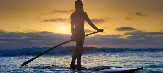 Stand Up Paddleboarding at sunset